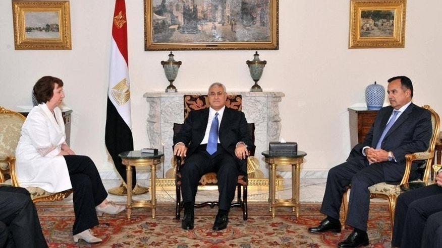 Picture made available by the Egyptian presidency on July 29, 2013 shows Egypt's interim president Adly Mansour (C) and Foreign Minister Nabil Fahmy (R) meeting with EU foreign policy chief Catherine Ashton in Cairo. Ashton held two hours of talks with Egypt's deposed president Mohamed Morsi, in custody since shortly after the July 3 coup.