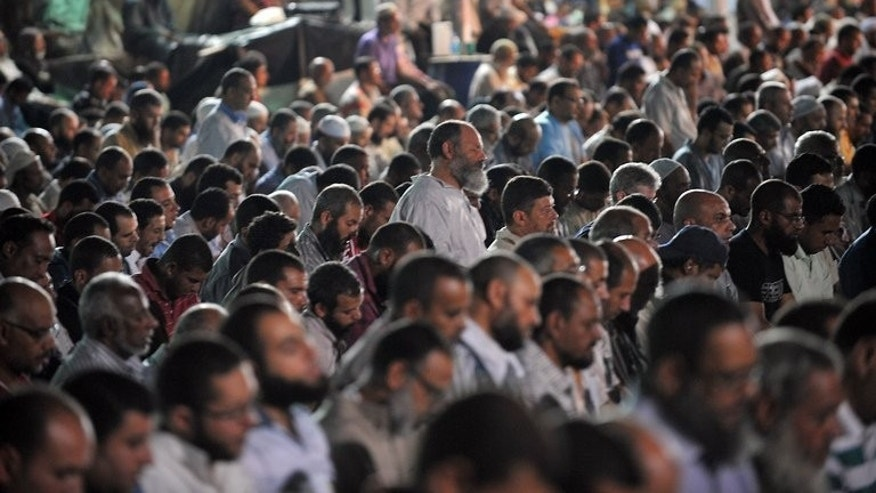 Egyption supporters of ousted president Mohamed Morsi perform evening prayer during their open sit in, in Cairo on July 30, 2013. The EU foreign policy chief held two hours of talks with the ousted Egyptian president as she pressed efforts to broker an end to an increasingly bloody crisis.