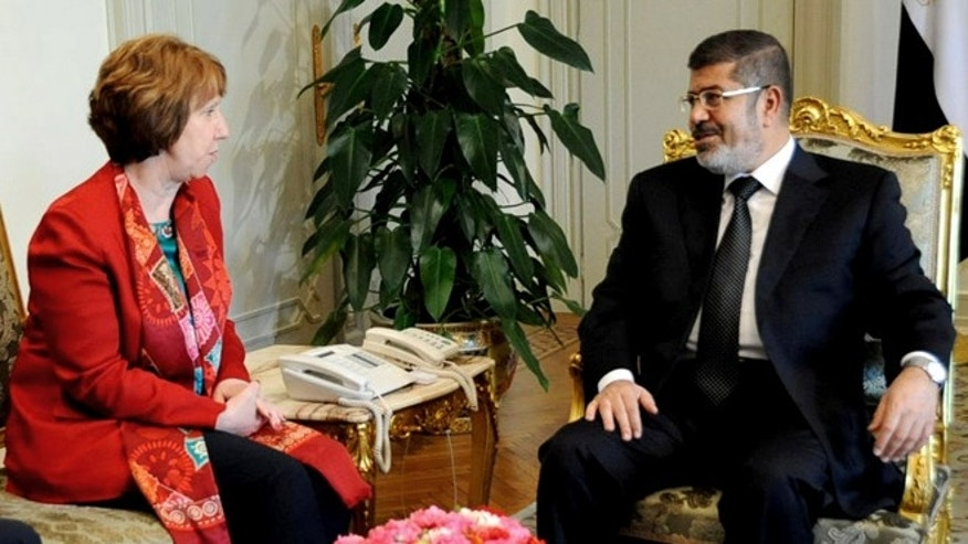 June 19, 2013: In this file image released by the Egyptian Presidency, Egyptian President Mohammed Morsi, right, meets with High Representative of the European Union for Foreign Affairs Catherine Ashton, at the Presidential Palace in Cairo, Egypt. Ashton held a two-hour meeting with  Morsi, the EU said on Tuesday, July 29, 2013, in the Islamist leader's first meeting with an outsider since the military deposed him nearly a month ago.