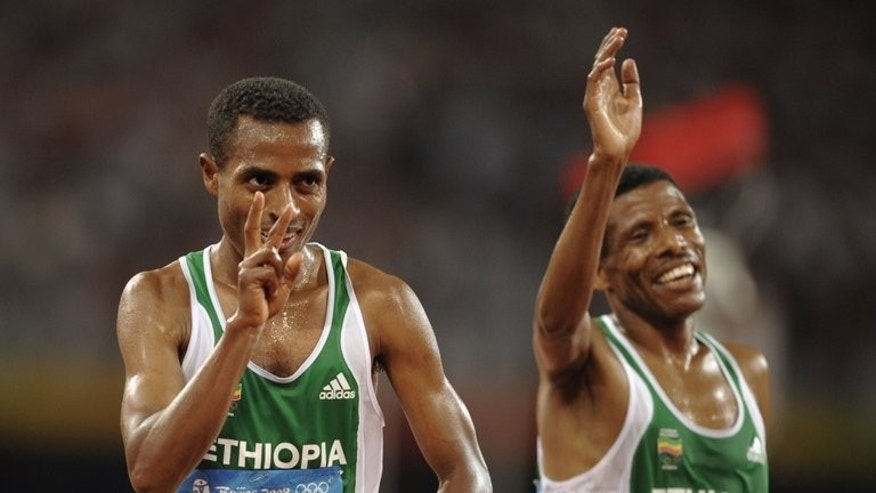 Haile Gebrselassie (right) and Kenenisa Bekele celebrate after the 10,000m at the Beijing Olympics in 2008. Ethiopian distance legend Gerbselassie is a two-time Olympic 10,000m gold medallist (1996, 2000) and won the World Championships at the distance four times from 1993 to 1999.