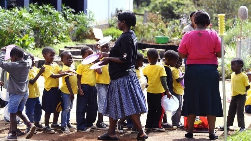 Pupils queue for lunch in a school on March 1, 2012 in Bulembu. Around three in 10 young children in Swaziland are stunted by hunger, and 270,000 workers are also physically affected, an official said Tuesday, citing a government-backed study.