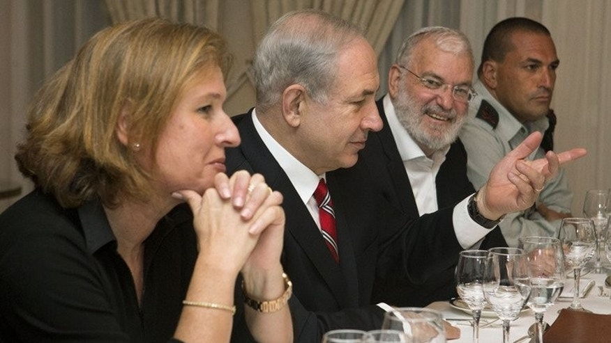 "Tzipi Livni, Israel's chief negotiator with the Palestinians (L) sits next to Israel's Prime Minister Benjamin Netanyahu, in Jerusalem on June 29, 2013. Justice Minister Livni hailed a ""positive"" mood at resumed peace talks with the Palestinians in Washington, the first in three years."
