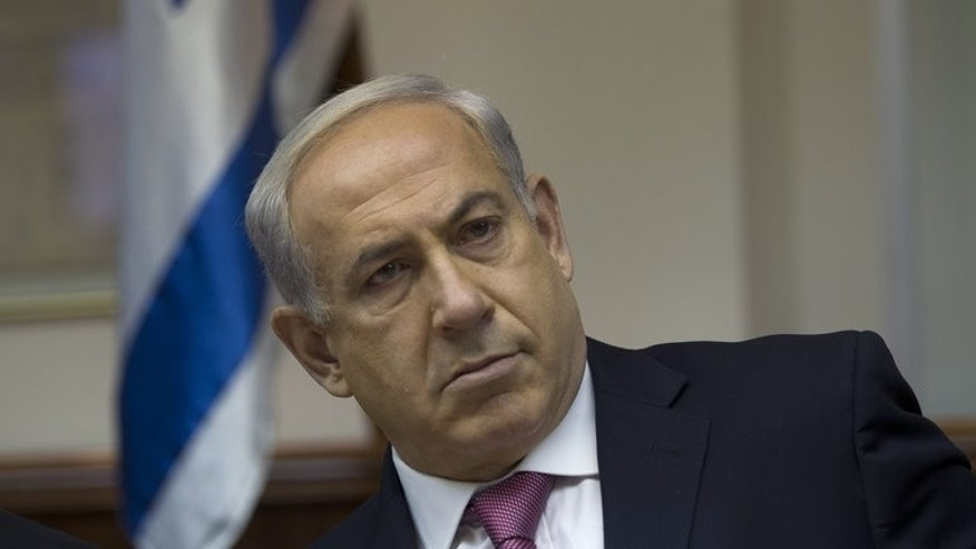 Israel's Prime Minister Benjamin Netanyahu (C) attends the weekly cabinet meeting in Jerusalem on July 28, 2013. As senior Israeli and Palestinian envoys resumed long-stalled peace talks in Washington, Israeli media questioned the motives of Netanyahu in taking to the negotiating table.
