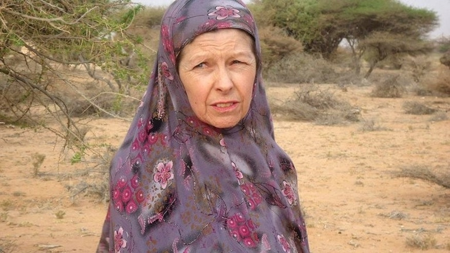 British hostage Judith Tebbutt, is pictured in the outskirts of Adado town in central Somalia on March 21, 2012. A Kenyan man has been sentenced to death for his role in the killing of British tourist David Tebbutt and the kidnapping of his wife, court officials have said.