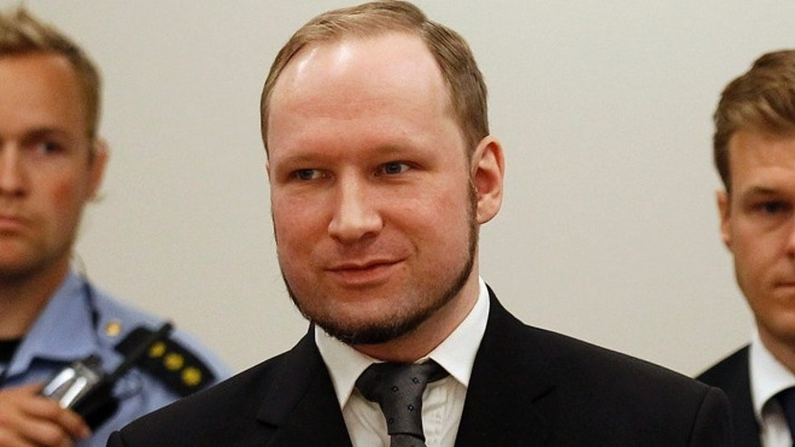 August 24, 2012: Norwegian mass killer Anders Behring Breivik smiles as he arrives at the court room in Oslo. Breivik was jailed for a maximum term on Friday when judges declared him sane enough to answer for the murder of 77 people last year, drawing a smirk of triumph from the self-styled warrior against Islam.