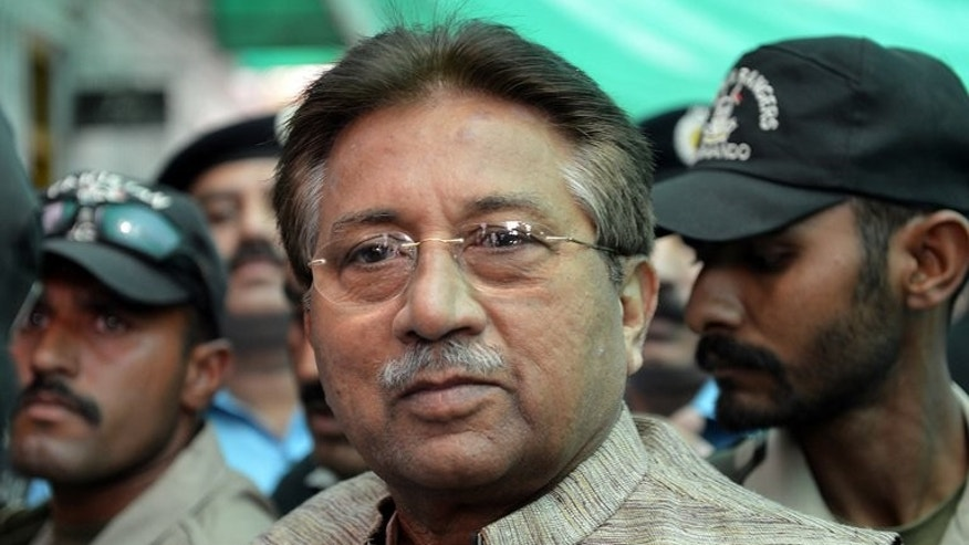 In this photograph taken on April 20, 2013, former Pakistani President Pervez Musharraf (C) is escorted by soldiers as he arrives at an anti-terrorism court in Islamabad. Prosecutors at a Pakistani court will next week charge Musharraf with criminal conspiracy and the murder of opposition leader Benazir Bhutto, lawyers said Tuesday.