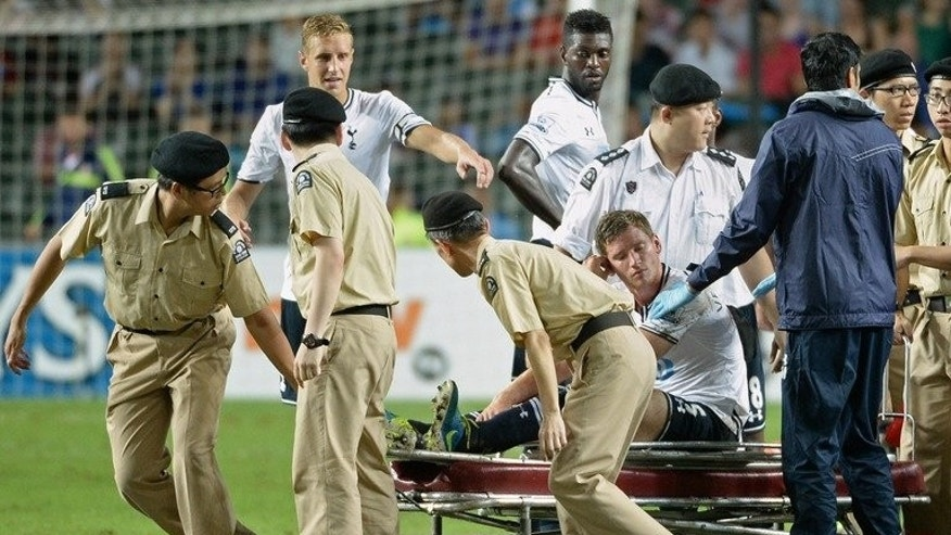 Tottenham Hotspur's defender Jan Vertonghen is taken off the field on a stretcher after injuring his ankle, during a Barclays Asia trophy semi-final match against Sunderland, at Hong Kong stadium, on July 24, 2013.