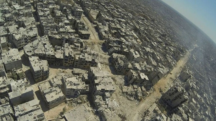 A handout image released by the Syrian opposition's Shaam News Network on July 29, 2013 shows an aerial view of destruction in the al-Khalidiyah neighbourhood of the central Syrian city of Homs. The regime's new victory in Homs and rebel advances in the north and south of Syria are signs that both sides are looking to make headway before much-touted peace talks.