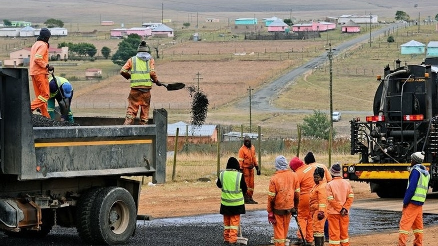 Workers improve a road opposite former South African President Nelson Mandela's home in Qunu on July 1. Almost 26 percent of South Africans are now out of work, according to official data released Tuesday, which showed a worsening of the country's already dire labour problems.