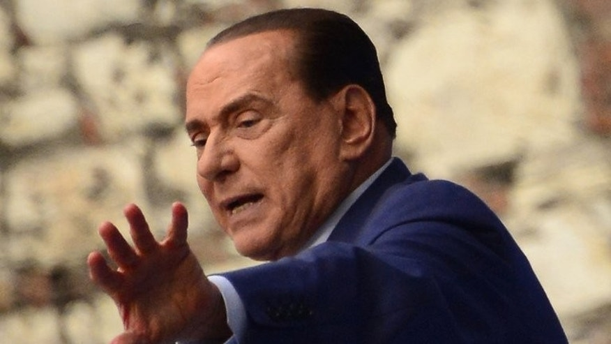 Former Italian prime minister Silvio Berlusconi delivers a speech during a rally organised by the People of Freedom party (PDL) against 'politicised magistrates' on May 11, 2013 in Brescia. Italy's top court begins crucial hearings for Berlusconi on Tuesday that will decide whether to confirm a one-year prison sentence and a five-year ban from politics.