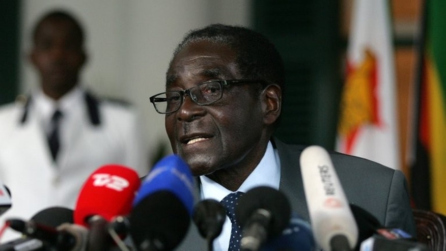 Zimbabwe president and Zanu PF presidential candidate, Robert Mugabe, speaks at a press briefing on July 30, 2013 at the State House. Crisis-weary Zimbabweans vote Wednesday in a fiercely contested election dominated by Robert Mugabe's bid to extend his 33 year rule and suspicions of vote rigging.