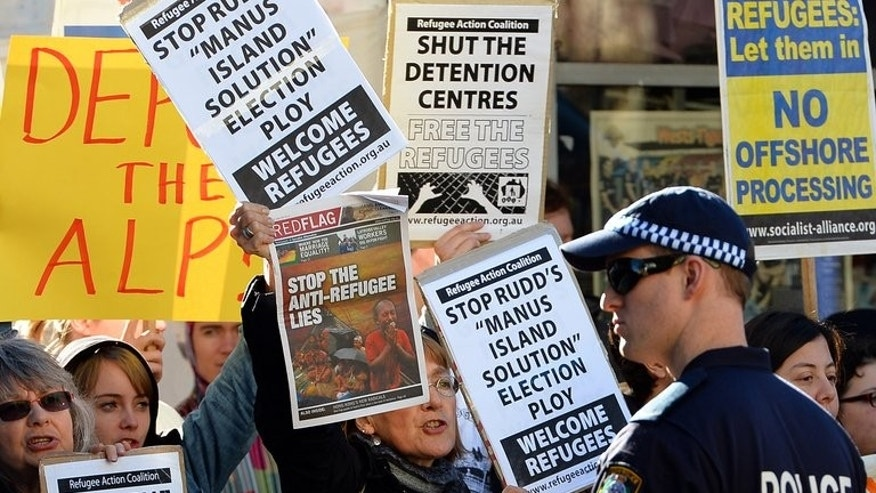People protest against the Australian government's new policy of resettling refugees in Papua New Guinea, in Sydney on July 22, 2013.
