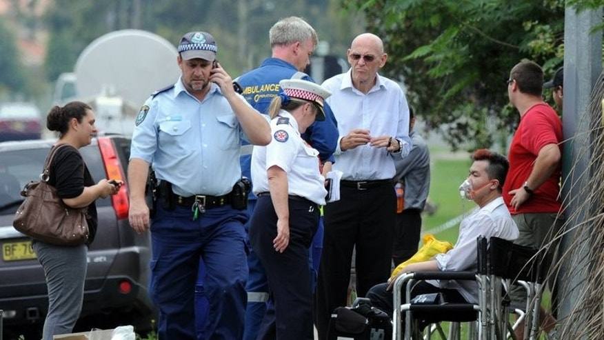 A man is given oxygen by ambulance staff after a fire engulfed a nursing home for the elderly near Sydney on November 18, 2011. A man convicted of deliberately lighting the blaze that ripped through the Quakers Hill Nursing Home, killing 11 elderly residents, has been sentenced to life in jail with no chance of parole.