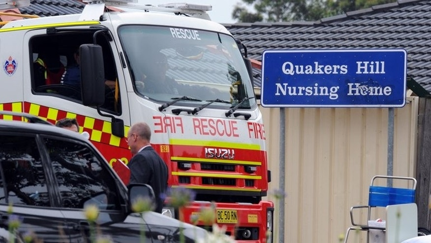 """A fire brigade vehicle is shown outside a nursing home for the elderly in Sydney, following a fire that killed 11 residents on November 18, 2011. Roger Dean, a nurse at the Quakers Hill Nursing Home, pleaded guilty to 11 counts of murder, telling police after the fire in 2011 that he had been """"corrupted with evil thoughts""""."""