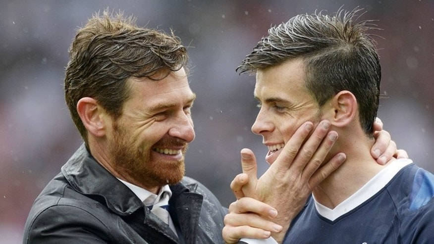 Andre Villas-Boas (left) hugs Gareth Bale after a game against Stoke City at the Britannia Stadium on May 12. Bale reported for training with Tottenham Hotspur on Wednesday, amid mounting rumours about a lucrative move to Real Madrid in a possible world record transfer deal.