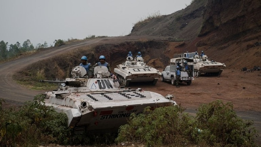 UN peacekeepers hold position behind Congolese army lines near Goma in the east of the Democratic Republic of the Congo on July 19, 2013. The United Nations on Tuesday threatened to use force against M23 fighters near Goma if they did not disarm within 48 hours.