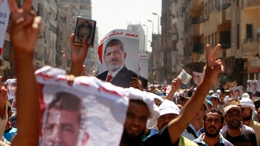 July 30, 2013: Supporters of deposed Egyptian President Mohamed Mursi shout slogans during a march from Al-Fath Mosque to the defence ministry, in Cairo.