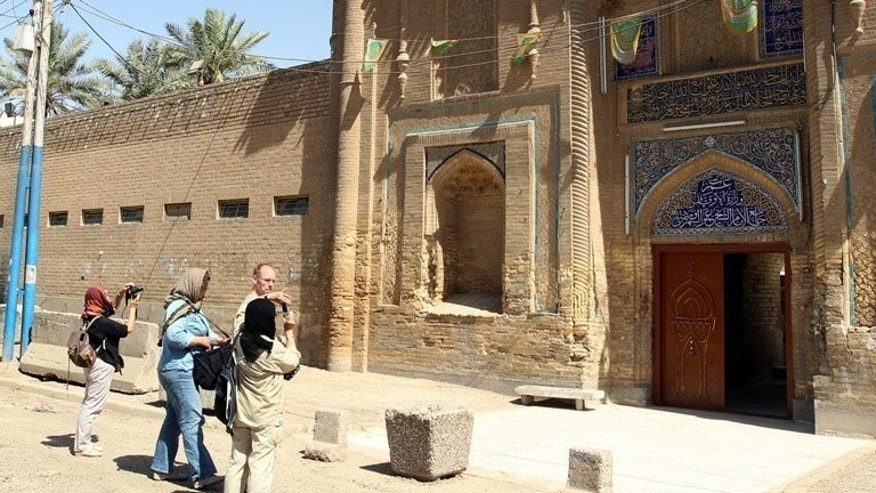 Tourists visit the Sheikh Omar al-Sahrawardi Mosque in Baghdad. As it trundles down busy roads, the minibus packed with tourists would be unremarkable except for two things -- its passengers are Westerners and the city they are in is Baghdad.