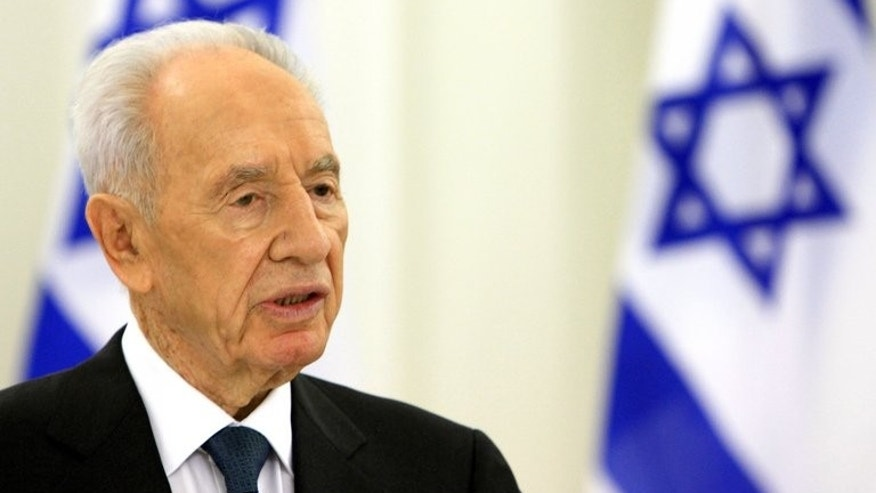 "Israeli President Shimon Peres speaks during a joint press conference with his Lithuanian counterpart in Vilnius, on July 31, 2013. Peres said he is ""hopeful"" that peace talks with Palestinians will lead to a two-state solution and bring prosperity to the Middle East."