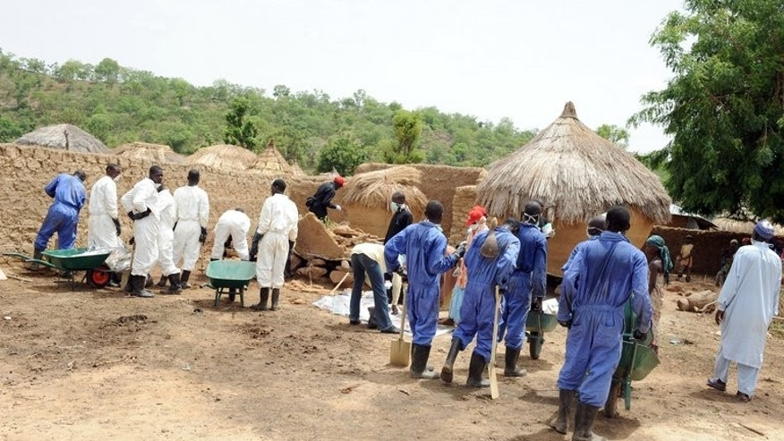 Health workers excavate soil contaminated with lead poison in Dareta village, in the Zamfara state on June 10, 2010. Medical charity MSF said Wednesday the Nigerian village that suffered an unprecedented and deadly lead poisoning outbreak had been cleared of the toxin, but that nearly 1,000 exposed children needed treatment.