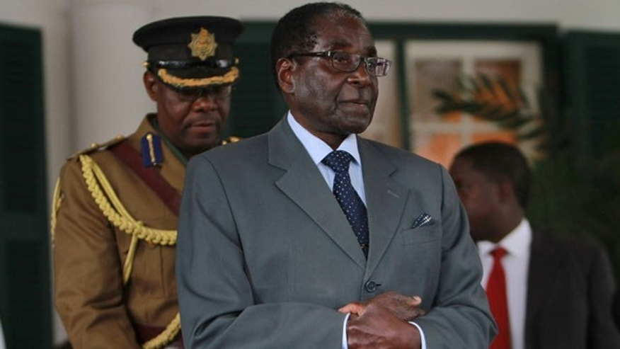July 30, 2013: Zimbabwean President Robert Mugabe addresses a press conference at State House in Harare.(AP Photo)