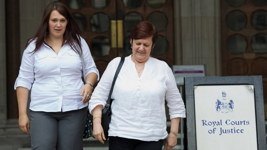 Beth (L) and Jane Nicklinson, daughter and wife of Tony Nicklinson who suffered from locked-in syndrome, leaving the High Court in central London on July 19, 2012. A paralysed road accident victim and Nicklinson's family lost their legal challenge at Britain's Court of Appeal on Wednesday for the right to die through assisted suicide.