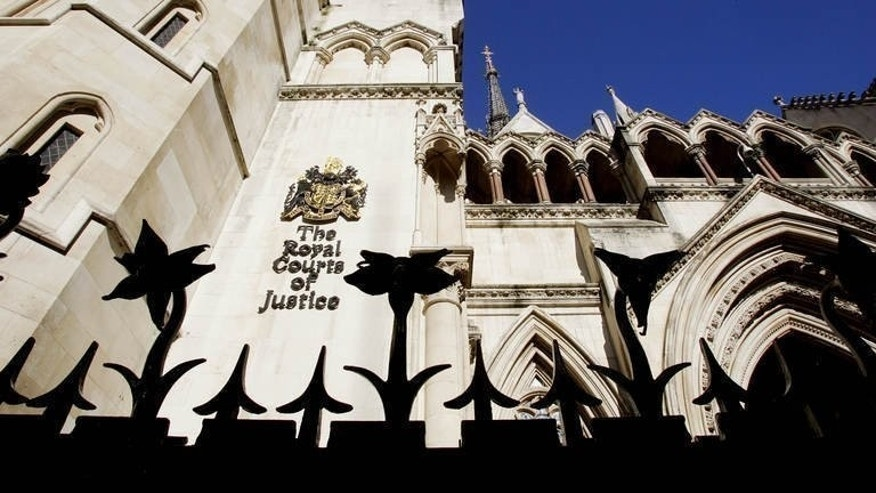 This picture shows the Royal Courts of Justice in London where the Court of Appeal - the second-most senior court in England - sits, October 7, 2004. A paralysed road accident victim and the family of a late locked-in syndrome sufferer lost their legal challenge at Britain's Court of Appeal on Wednesday for the right to die through assisted suicide.