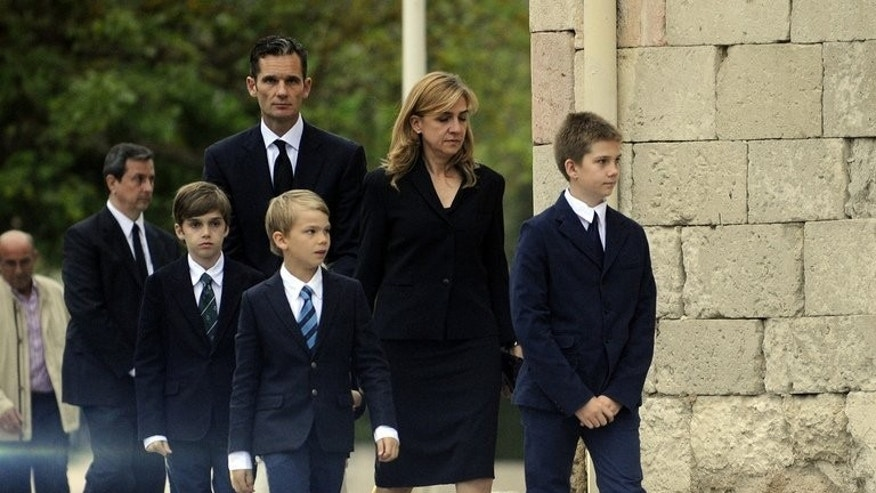 Spain's Duke of Palma Inaki Urdangarin (L), arrives with his wife Spain's Princess Cristina (C) and their four children at San Prudencio church in Vitoria, on May 12, 2012. Cristina is moving with her children to work in Switzerland, her employer said, two months after a court named her in a corruption case against her husband.
