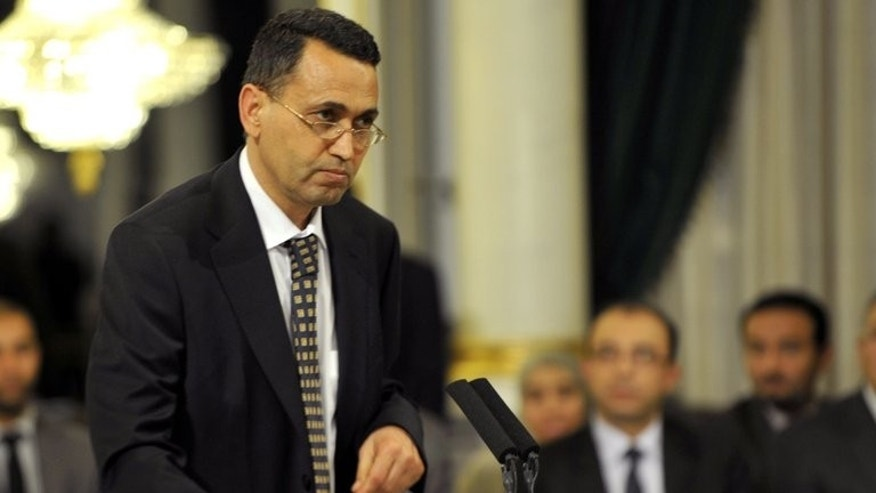 Tunisian Education Minister Salem Labiadh takes an oath of office on March 13, 2013 at the Carthage Palace in Tunis. Labiadh submitted his resignation on Wednesday, amid a political crisis prompted by the murder of an opposition MP, government spokesman Abdessalem Zbidi said.