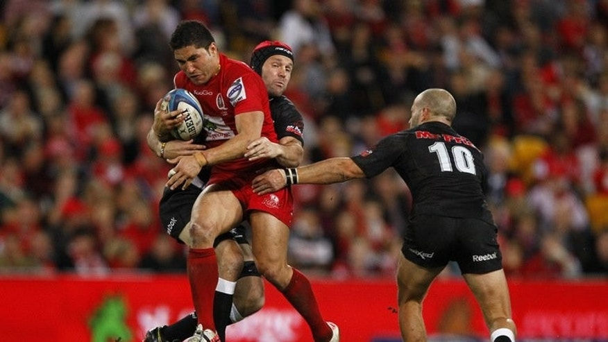 Queensland Reds centre Anthony Faingaa (L) during a Super Rugby match in Brisbane on July 21, 2012. He will be out of rugby for up to six months after undergoing shoulder surgery, the Australian Rugby Union said Thursday.