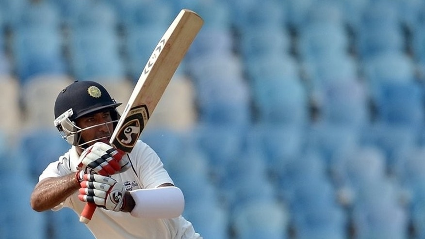 Cheteshwar Pujara plays a shot against England at The D.Y. Patil stadium in Navi Mumbai last November. India are tight-lipped about their intentions though Pujara appears first in line to be called into the team for the fourth one-day international in Bulawayo on Thursday.