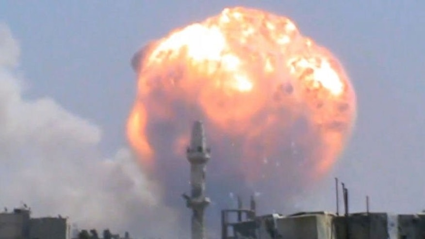 An image grab taken from a video uploaded on Youtube on August 1, 2013 allegedly shows smoke and fire following a blast at an ammunition dump in Syria's central city of Homs.