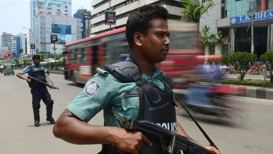 Bangladeshi police stand guard in Dhaka on May 12, 2013. Nationwide protests kicked off in February, led by the Jamaat-e-Islami Islamic party over sentencing of its leaders for war crimes, sparking battles with security forces and the deadliest political violence since independence.