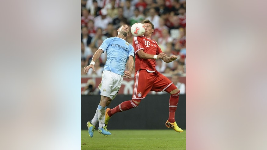 Bayern Munich's striker Mario Mandzukic (R) and Manchester's defender Pablo Zabaleta fight for the ball during the Audi Cup football final match in Munich, southern Germany on August 1, 2013. Bayern won 2-1.