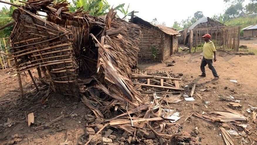 "A July 25 picture of a house in Kaenzi village said to have been bombed by a DR Congo government helicopter. A new UN intervention brigade will be used for the first time to help the DR Congo army set up a ""security zone"" around Goma, the international body said."