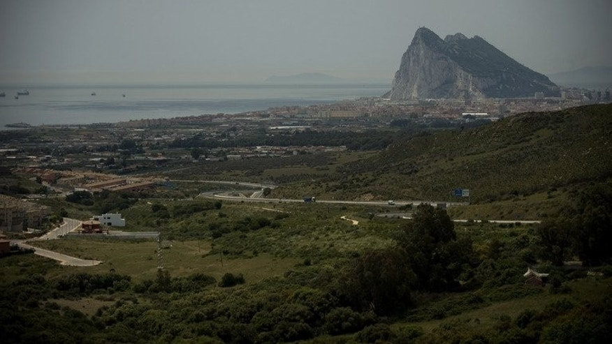 """A picture taken from Linea de la Concepcion on May 25, 2012 shows the famous Rock of the British colony of Gibraltar. The tiny British-held territory complained to the European Union Thursday over delays at its border crossing with Spain which it said were """"deliberately"""" caused by Spanish authorities."""
