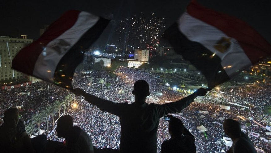 Supporters of Egyptian Armed Forces General Ahmed Fattah al-Sisi rally at Tahrir Square in Cairo on July 26, 2013. In the weeks since the army he heads evicted president Mohamed Morsi from office after nationwide protests against the elected Islamist head of state, Sisi has become something of a national icon.