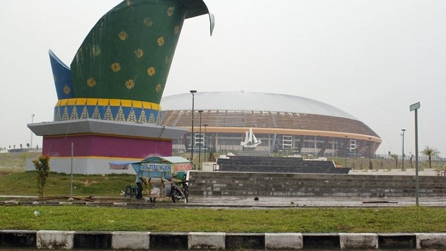 A general view of the under construction main sports stadium to be used for the Islamic Solidarity Games in Pekanbaru located in Indonesia's Sumatra island on April 2, 2013. Indonesia has moved the venue for the Islamic Solidarity Games for a second time, an official said, this time to a city that co-hosted the ill-fated 2011 Southeast Asian Games .