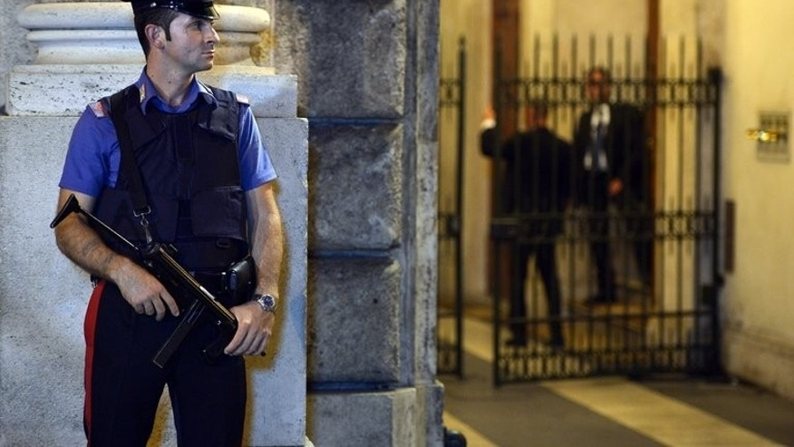 An Italian police officer stands guard in front of Silvio Berlusconi's residence, on August 1, 2013 in Rome. Italy's former prime minister, Berlusconi, has lost his final appeal against a tax fraud sentence in a ruling that jolted the political establishment on Friday but left the government in place for now.