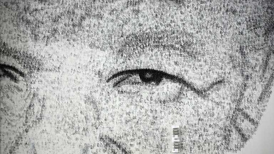 "A close-up detail of Shanghai-based Belgian artist Phil Akashi's portrait of South African peace icon and former boxer Nelson Mandela, which he forged by pounding the wall 27,000 times with a boxing glove bearing Chinese character for ""freedom"", in Shanghai, on August 1, 2013."