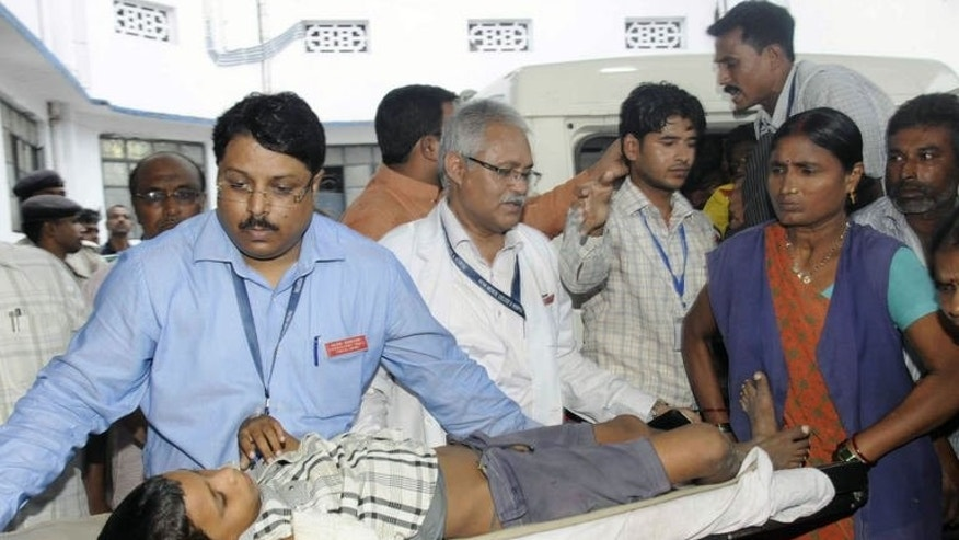 A child, who fell ill from the drinking water at his school, is brought to the Patna Medical College and Hospital in Patna on August 1, 2013. About a dozen children fell ill and were taken to hospital after drinking suspected contaminated water at their school in eastern India, a hospital official said.