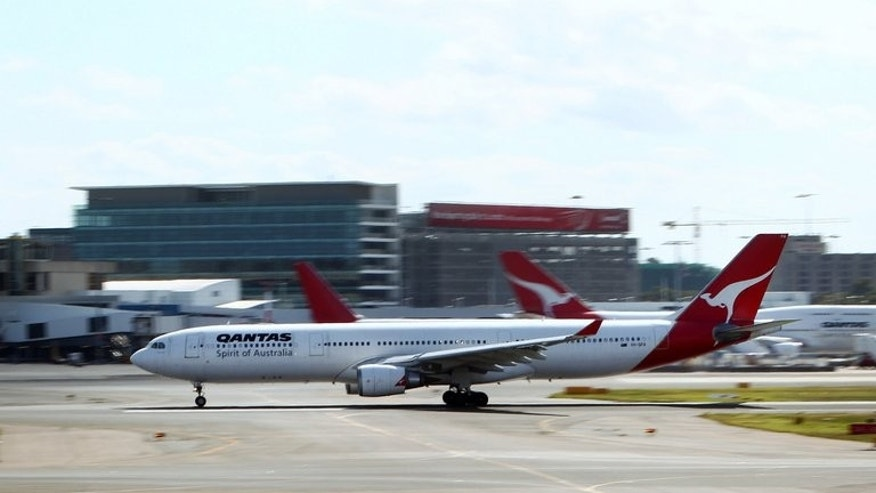 A Qantas passenger plane departs from Sydney Airport, on October 31, 2011. Dozens of people have been rushed off a Qantas flight for medical treatment in Sydney after a stomach bug struck mid-journey, triggering a mass vomiting episode.