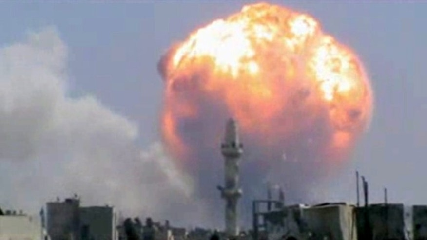 Aug. 1, 2013: In this image taken from video posted by Ugarit News, which has been authenticated based on its contents and other AP reporting, purports to show a fireball from an explosion at a weapons depot set off by rocket attacks that struck government-held districts in the central Syrian city of Homs. The blasts sent a massive ball of fire into the sky, killing scores and causing widespread damage and panic among residents, many of whom are supporters of President Bashar Assad.