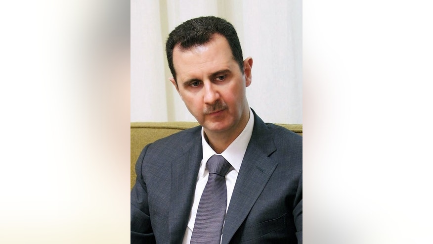 "A handout picture shows Syrian President Bashar al-Assad giving an interview in Damascus, on July 02, 2013. Assad says he is ""sure of victory"" over rebels fighting to topple him, in an Army Day message carried by state media."