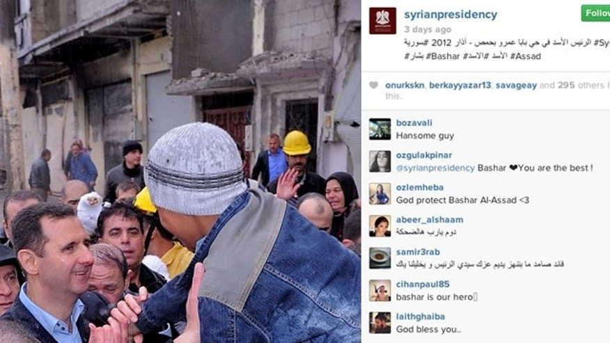 "This undated photo posted on the official Instagram account of the Syrian Presidency purports to show Bashar Assad visiting Baba Armr, Homs province, Syria in 2012. Comments in Arabic read ""keep that smile,"" and ""a successful leader that never flinches, keep your pride, Mr. President."" (AP Photo)"