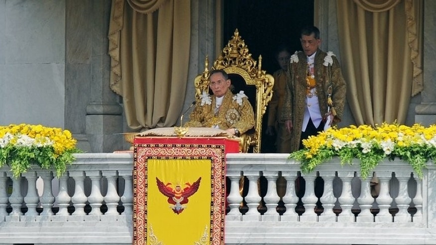 Thai King Bhumibol Adulyadej (C) sits on the throne after delivering an address at the Royal Plaza watched over by Crown Prince Maha Vajiralongkorn on December 5, 2012. The elderly monarch, who with 67 years on the throne is the world's longest-serving royal, has suffered from a range of ailments since being admitted with respiratory problems in 2009.