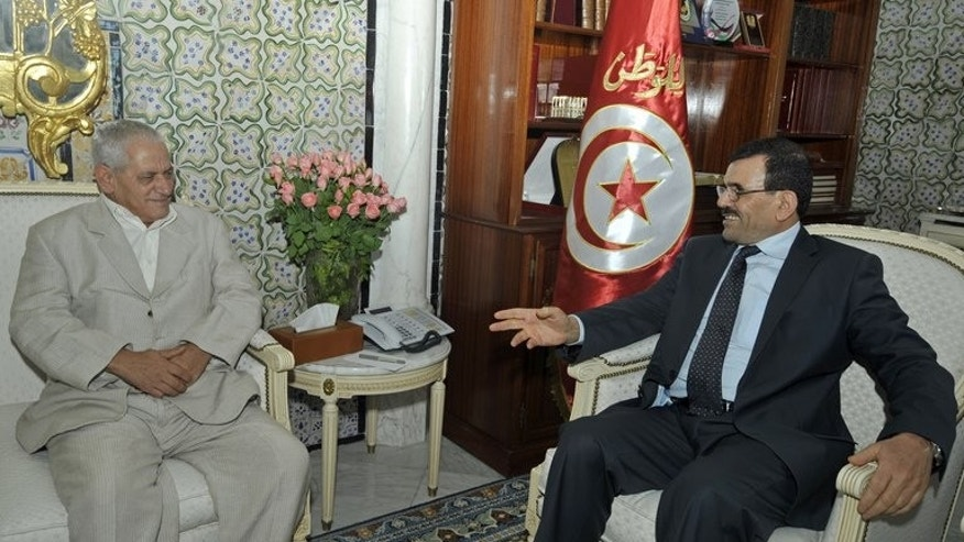 Prime Minister Ali Larayedh (right) meets trades union leader Houcine Abbassi in Tunis on Thursday. Tunisia's leaders started talks on Thursday with opposition and civil society representatives to try to defuse the country's latest political crisis, prompted by last week's murder of an opposition MP.