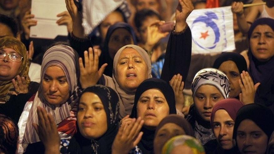 "Ennahda supporters protest in Tunis on Wednesday. President Moncef Marzouki, a secular ally of the ruling Islamist Ennahda party, met with leaders of the Republican Party, who are demanding ""a national salvation government"" led by an independent, a video released by the presidency showed."