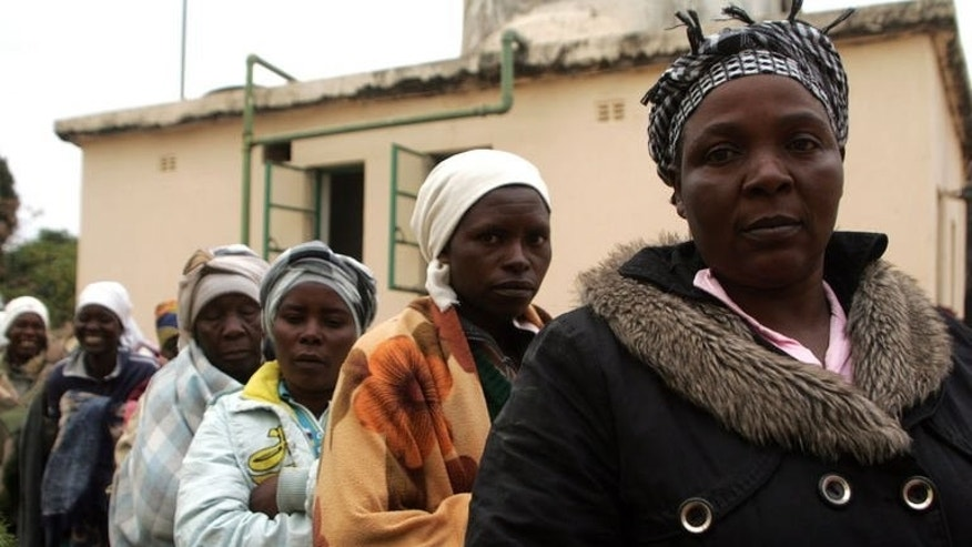 Voters in Epworth township queue to vote at a polling station during presidential elections in Zimbabwe on July 31, 2013. Zimbabwe's disputed election has plunged the country back into a deep political crisis and could open the way for decades more of autocratic rule.