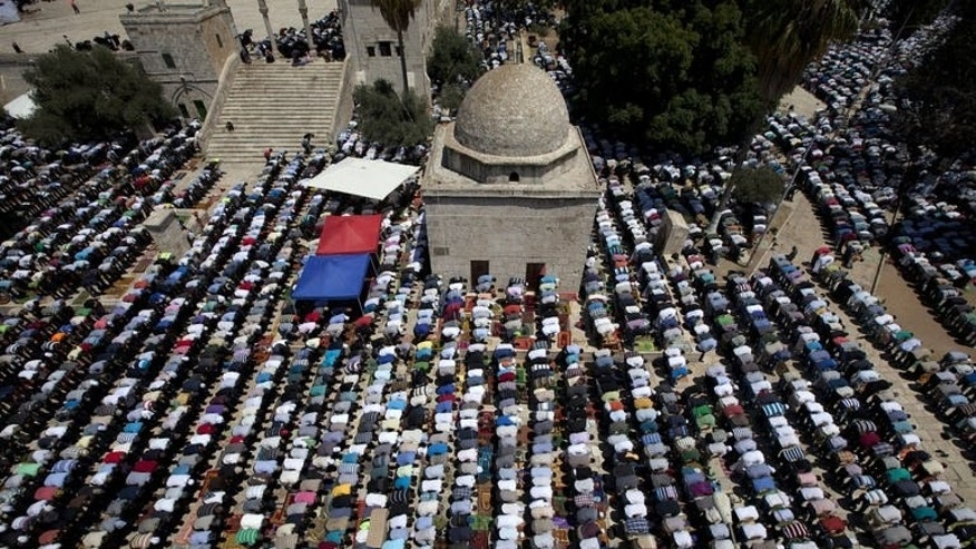 Palestinian Muslim worshipers pray at the al-Aqsa mosque compound, Islam's third holiest site, on August 2, 2013 in Jerusalem's old city on the last Friday of the Islamic holy month of Ramadan.